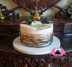 I really loved painting this cake. The original design was by Sweetlake Cakes & beautifully appropriate for a gentleman's birthday. I layered ivory, chocolate, black & metallic silver to create the hand-painted design on the sides. The...