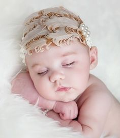So cute! Can't see her ginger hair tho!! :( not lovin this headpiece is rather see her hair this headband distracts from the baby