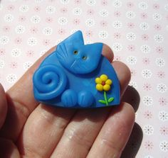 Polymer Clay Blue Cat with Yellow Flower pin or magnet via Etsy