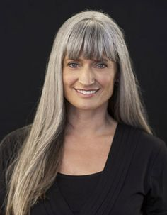 long grey hair with bangs. love it! Beauty is at every age, and we can embrace God's gifts. A wife's hair is just naturally beautiful, a glory to her and a joy to her husband. Quit trying the artificial route and trust in how you were made.