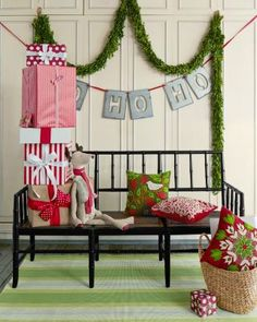 Give your entry way an easy update with festive throw pillows and garlands.