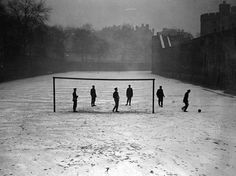 Guards play football in the snow at the Tower of London, January 1910. Photo: Fox Photos/Hulton Archive/Getty Images