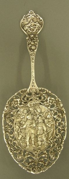 Antique, Silver reticulated serving spoon with Netherlands hallmark.