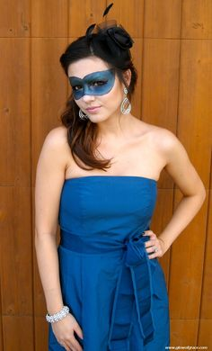 Need a quick, last minute costume for Halloween? Grab a dress, a pair of heels and make your mask out of makeup with this tutorial.