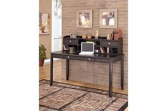 "The Carlyle Home Office Desk from Ashley Furniture HomeStore (AFHS.com). The sleek design of the contemporary styled ""Carlyle"" home office collection brings a rich sophistication into any home."