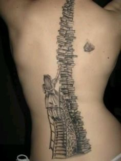 Stack of books spinal tattoo - keep reading!
