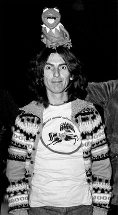 Kermit the Frog is on George Harrison's head...your argument is invalid...