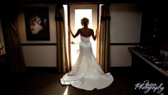 Simple pose for your bridal portrait session to show off the back of your dress. This is from an indoor natural light session.