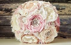 This is a listing for the 11 bridal bouquet made in a vintage inspired style with layers of satin, lace, tulle, chiffon and organza fabrics in a