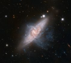 HubbleSite - NewsCenter - Chance Alignment Between Galaxies Mimics a Cosmic Collision (06/14/2012) - Release Images