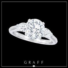 A 2.01ct Round Diamond with Pearshape Diamond Shoulders.......