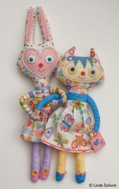 Dolls made using Timeless Treasures Flutter fabric line designed by Linda Solovic