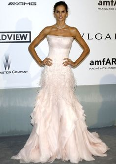Izabel's in a strapless pink Emilio Pucci gown