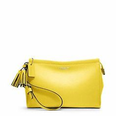 @Coach leather wristlet in lemon. loving everything yellow right now.