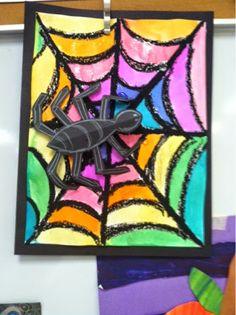 Een vrolijk gekleurd spinnenweb van zwarte wasco en ecoline. De ruimtelijke spin maakt het af!
