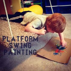 painting while prone on the platform swing