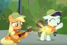 Filly Applejack playing guitar while Ra-ra sings.