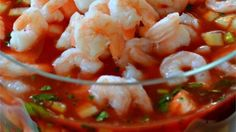 Shrimp with tomatoes, avocados, sweet onion, and cilantro bask in a zesty tomato salsa for an appetizer that looks beautiful when served in a glass salad bowl. Serve with saltine crackers.