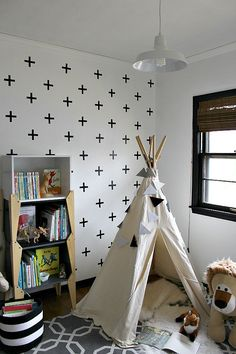 DIY kid bedroom makeover with #DIY crosswall, teepee, black, white, and gray colors, bookcase, large lion stuffed animal, closet turned art desk nook.