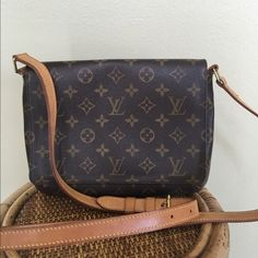 """✨LOUIS VUITTON MUSETTE TANGO LONG STRAP✨ I purchased this bag from a reputable posher and it is just too small for me.  The threading on the interior pocket is coming undone on one side and one of the straps has a small tear by the hardware (shown in pic #4) there is also a small interior stain.  Great bag for everyday use.  Comes with dust bag.  Date code is LM0013. W 10.2 × H 7.9 × D 2.8 """"  Strap 21.3 - 26.0 """" TRADES LOWBALL Louis Vuitton Bags Crossbody Bags"""