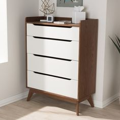Shop for Mid-Century White and Walnut 4-Drawer Chest by Baxton Studio. Get free shipping at Overstock.com - Your Online Furniture Outlet Store! Get 5% in rewards with Club O! - 22328070