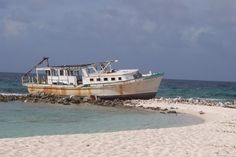"""For 13 years, this boat gave Sandy Island (see """"THE Beaches"""") the nickname of """"Gilligan's Island."""" Blown there by Hurricane Luis is 1995, it was finally dislodged by Hurricane Omar in 2008, never to be seen again."""
