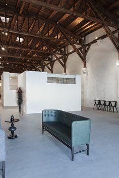 Showroom de tradición y / Arquitectos NORM