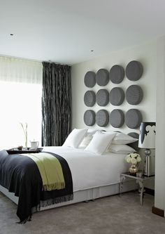 Black, white and gray bedroom with accent colors. Cute!