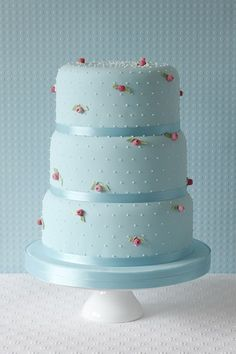 Blue #wedding cake ideas: http://www.weddingandweddingflowers.co.uk/article/1168/lookbook-blue-wedding-cakes