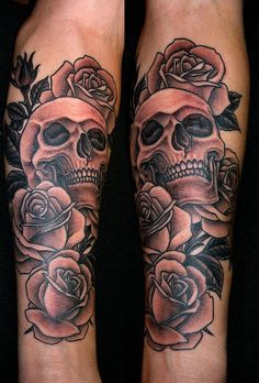 black and grey skull tattoo with roses