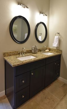 """Gramercy Midnight Double Vanity: 60"""" wide, 34.5"""" tall, 2 doors, 4 drawers with stainless steel knobs and Santa Cecilia Gold granite."""