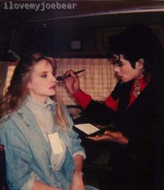 MJ applying and practicing makeup techniques on his makeup artist of many years Karen Faye!!!..=)