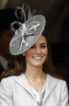 Feathers! Ribbons! Mesh! This beautiful metallic-hued fascinator was the perfect accent to Princess Kate's outfit for the annual Garter Service in June 2011.