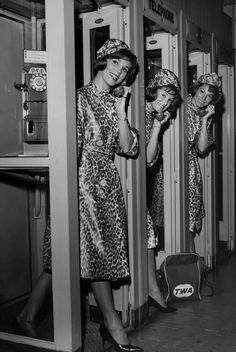 Pop singers, the McGuire Sisters (from left: Christine McGuire, Phyllis McGuire and Dorothy McGuire), pose wearing leopard skin print outfits in telephone booths at New York International Airport in New York City, New York, USA, 16 May 1962.