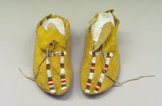 Kiowa, Native American. Pair of Woman's Moccasins, early 20th century. Deerskin, glass bead, pigment, 9 13/16 x 3 15/16 in.  (25.0 x 10.0 cm).