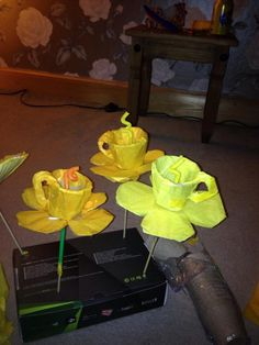 Lemon tea cups. These are the tea cups Willy Wonka pick from the bush and drinks out of at the end of the 'Imagination' song in the original movie after the characters are in the main room of the factory where everything is edible. I made these from a paper plate cut into petal shape, a small cardboard plant pot (they come in packs of 20 for £1) wrapped in tissue paper, and bendy straws from ikea for the stocks in the middle. Very easy to put together! Willy wonka theme