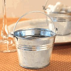 Miniature Silver Galvanized Favor Pails / Buckets  Item #:LFC-4673 Our Price: $1.15 As Low As:$0.65 Availability:Non-Personalized Ships Next Business Day Personalized Ships in 3-4 Business Days