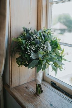 Beautifully romantic wedding on a DIY budget. Gypsophila, eucalyptus and thistle foliage wedding bouquet. Non-religious wedding ceremony at Prested Hall, Essex. Bride wears a David's. Bouquet Bride, Diy Wedding Bouquet, Diy Bouquet, Bridesmaid Bouquet, Floral Wedding, Trendy Wedding, Non Flower Bouquets, Greenery Bouquets, Bohemian Wedding Flowers