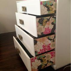 Update a dresser by using wallpaper to add a pop of color and pattern to the side of the drawers.