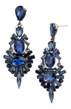 Obsessing over these chandelier earrings that add a statement-making final touch to the look.