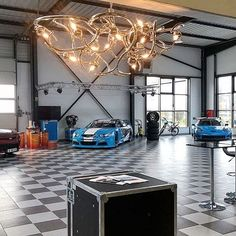 Our partner in France Lumières d'Alsace recently installed the Eve chandelier in a location where the adrenaline always reigns: amidst the racing cars of the Pegasus Racing team. We wish the drivers the best of luck in their pursuit for new records! #decorativelighting #interiordesign #modernlighting  For more information visit our website: WWW.BRANDVANEGMOND.COM Contemporary Chandelier, Contemporary Design, Racing Team, Alsace, Pegasus, Light Decorations, Modern Lighting, Reign, Chandeliers