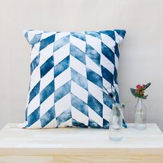 Anything that looks like it belongs at a beach house, and I am totally there, these pillows included!