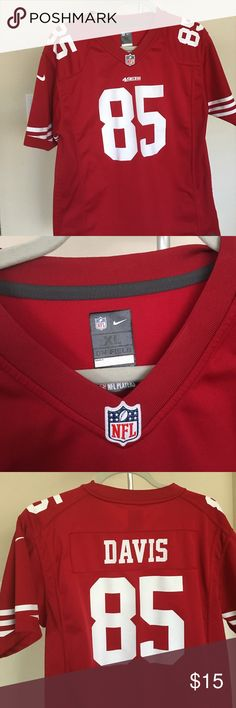 49ers jersey This is a Vernon Davis jersey. He is no longer with the team but was a excellent player. The jersey is still in good condition. And I'm willing to take an offer. Nike Shirts & Tops