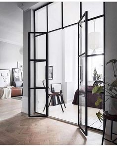 Living Room Monochrome home with a glass partition via Coco Lapine Design Modern Interiors Interior Architecture Minimalist Contemporary Interior Design Modern Livin. Scandinavian Doors, Scandinavian Apartment, Scandinavian Interiors, Scandinavian Design, Modern Scandinavian Interior, Home Interior, Interior Architecture, Interior Doors, Stylish Interior