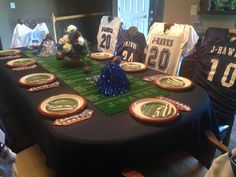I hosted  my daughter and her friends for their high school homecoming dinner. I used the guys football jerseys as chair covers. My table runner I made out of turf and sprayed painted the lines, numbers on it to make it look like a football field. It was a really fun and easy and cheap table theme. The kids loved it!
