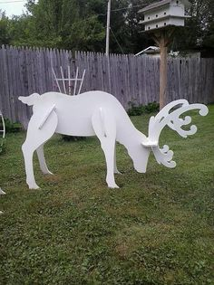 Outdoor White Reindeer Display These Elegant White Reindeer In Your Yard This Christmas. they also look great when you add my Santas Sleigh Handmade Wood Yard Art Display Reindeer Head Up-55 Tall Reindeer Head Down-29 Tall All of my pieces are made from 1/2 inch high quality plywood and painted with acrylic craft paint. Please note, my yard displays may vary from pictures, they are hand-made no two items will be exactly the same so there may be slight variances in color Each piece i...