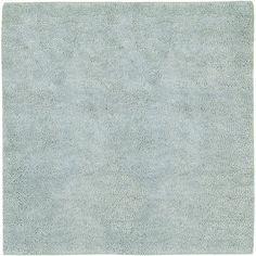 Ultra plush wool rug shown in 8' square size; Glacier Mist color, a pale blue green. The entire Aros collection is available in 15 different colors and several different sizes to fit your needs. (AROS-11)