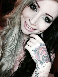 Double Nose Piercing . Tunnels . Chest Piece . Hand & Arm Tatts . Blonde & Black Hair . Gorgeous Makeup . Great Smile . Beautiful Girl .