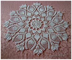 Crochet Doily. Did not see a pattern, but there is a chart and several close ups.