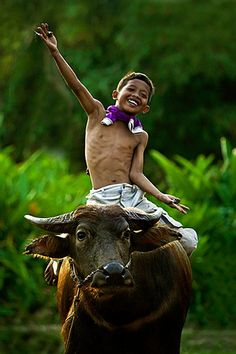 Boy, feeling like a winner in the village, Indonesia, photo by Rarinda Prakarsa @photo.net